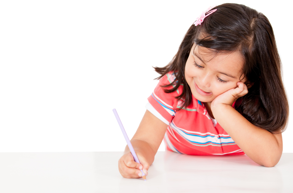 Little girl coloring - isolated over a white background